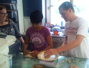From left to right: Beth, Kriti, and Tim kneading dough.